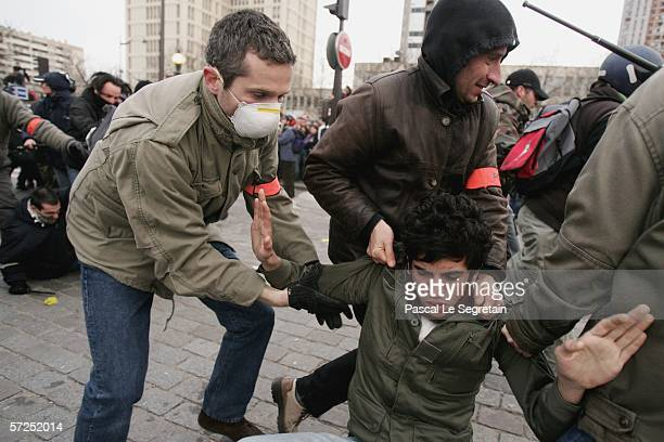 Police officers arrest a protester at the end of a protest against Youth Employment Contract known as CPE on April 4 2006 in Paris France