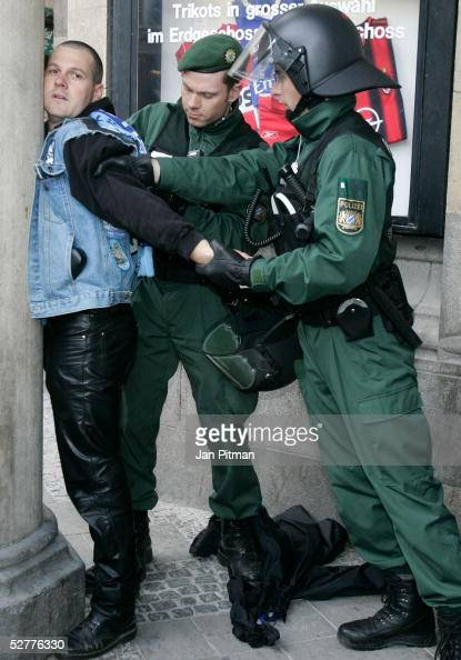Police officers arrest a protester during a picket of NeoNazis in front of the city hall on May 8 2005 in Munich Germany European nations are marking...