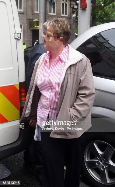 POLICE Police officers arrest a woman at Park Lane Safe Deposit after a raid in connection with suspected money laundering operations