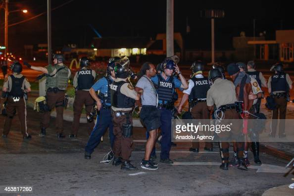 Police officers arrest protesters during a protest on August 18 2014 for Michael Brown who was killed by a police officer on August 9 in Ferguson...