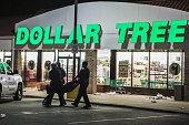 Police officers arresting looter outside dollar tree Police detain a looter outside Dollar Tree market during clashes over the decision in the...