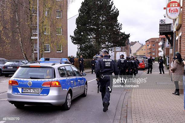 Police officers arrive at Schaufenberger Strasse street where they possibly made two arrests on November 17 2015 in Alsdorf Germany Police announced...