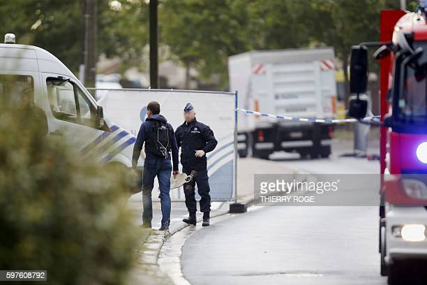Police officers arrive at the National Institute for Criminalistics and Criminology where an explosion took place early on August 29 in...