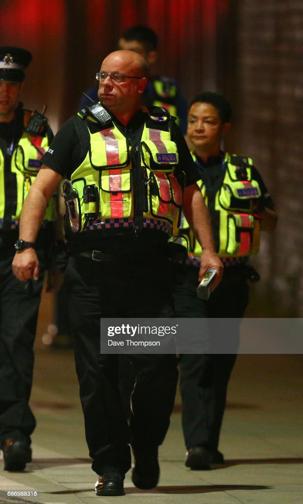MANCHESTER, ENGLAND - Police officers arrive at Victoria Railway Station, close to the Manchester Arena on May 23, 2017 in Manchester, England. There have been reports of explosions at Manchester Arena where Ariana Grande had performed this evening. Greater Manchester Police have have confirmed there are fatalities and warned people to stay away from the area.