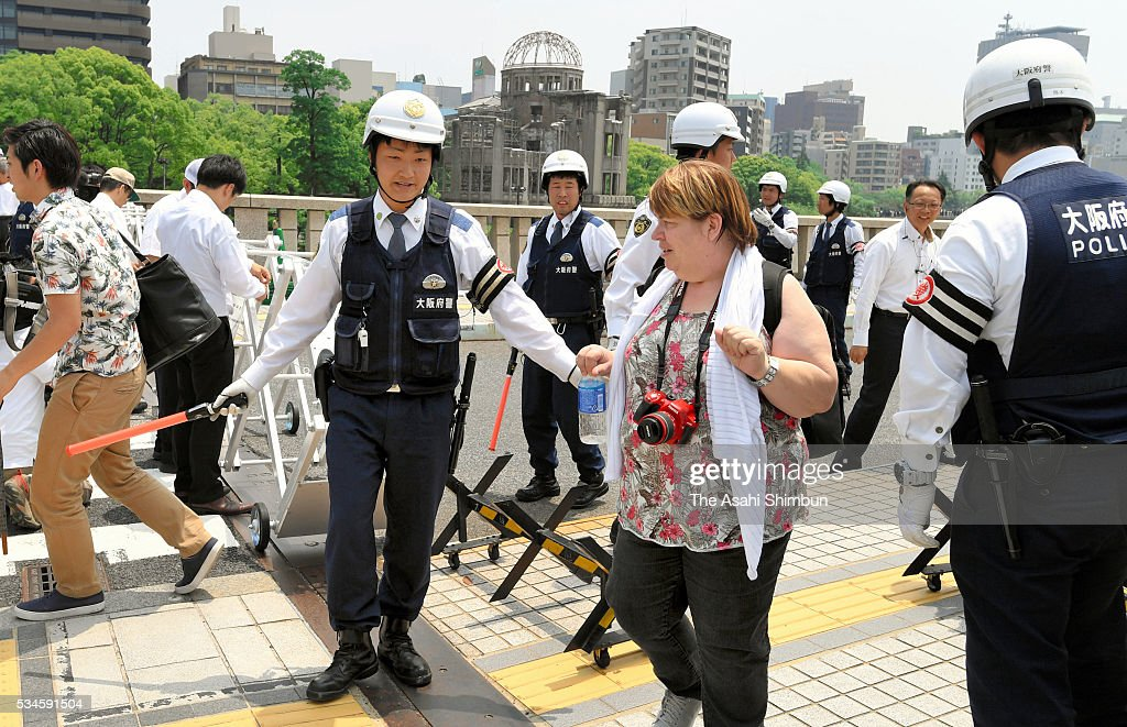 Police officers ask visitors to leave to close the Hiroshima Peace Memorial Park in preparation for the visit by U.S. President Barack Obama on May 26, 2016 in Hiroshima, Japan. Obama becomes the first sitting U.S. president to visit Hiroshima, where the first atomic bomb was dropped in 1945 at the end of World War II.