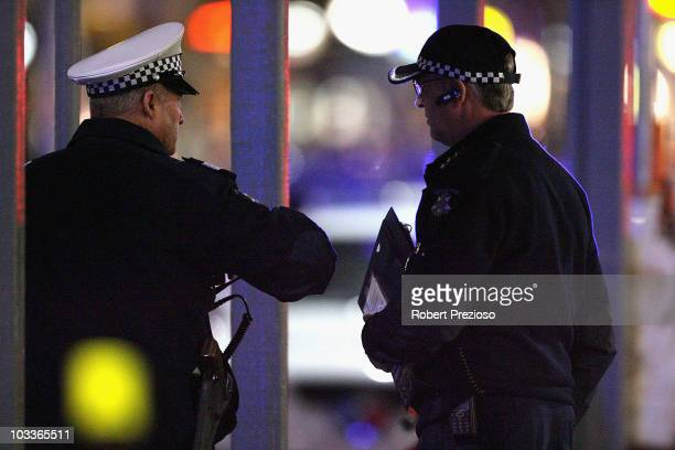 Police officers asses the crime scene where two men were shot dead on Lygon Street in the CBD on August 13 2010 in Melbourne Australia The two men...
