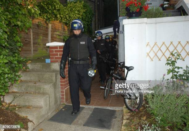 Police officers at a property in Anerley south London during a series of coordinated dawn raids launched to smash a major student visa immigration...