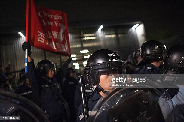 Police officers at a standoff against prodemocracy protesters outside Legislative Council building on November 19 2014 in Hong Kong Hong Kong's high...