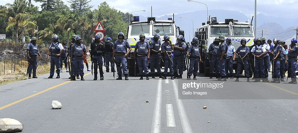 Police officers at the N1 De Doorns protest on January 9, 2013, in Cape Town, South Africa. Farm workers protested, demanding wages of R150 per day.