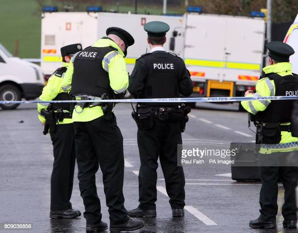 Police officers at the scene where one of their colleagues was killed in an under car booby trap explosion in Omagh Co Tyrone today