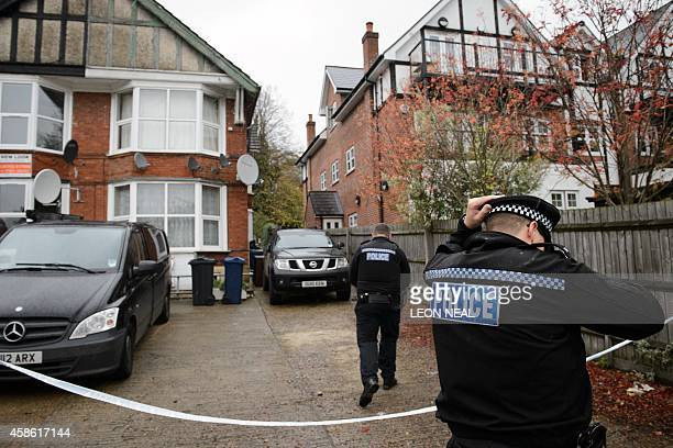 Police officers attend a residential address in High Wycombe Buckinghamshire north west of London on November 8 in connection with the arrest of four...
