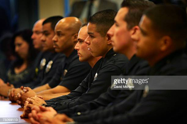 Police officers attend a role call and press conference where Los Angeles Mayor Antonio Villaraigosa and police Chief William Bratton announced the...