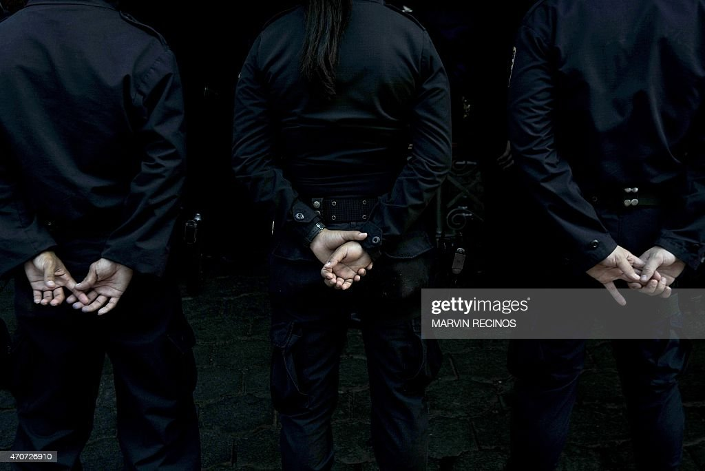 Police officers attend the funeral of their colleague Wendy Alfaro a National Civil Police female officer murdered by members of the 18st gang in...