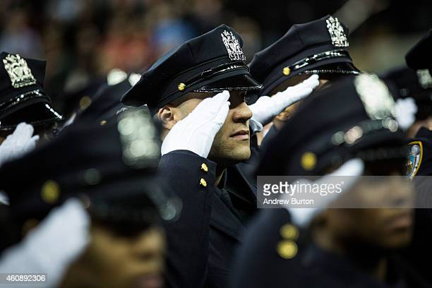 Police officers attend their New York Police Department graduation ceremony at Madison Square Garden on December 29 2014 in New York City The Mayor's...