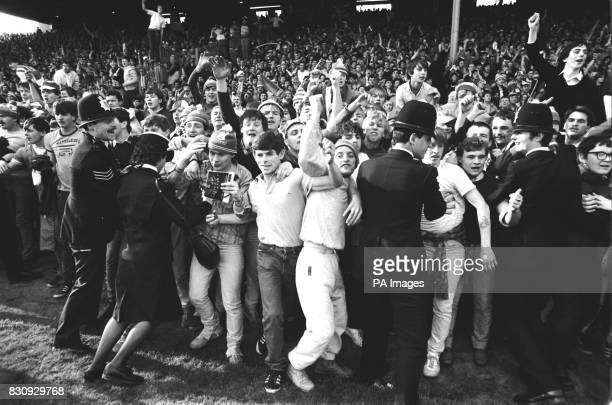 Police officers battle with rival soccer fans at the end of the FA Cup semi final between Everton and Southampton at Highbury London At least 80...