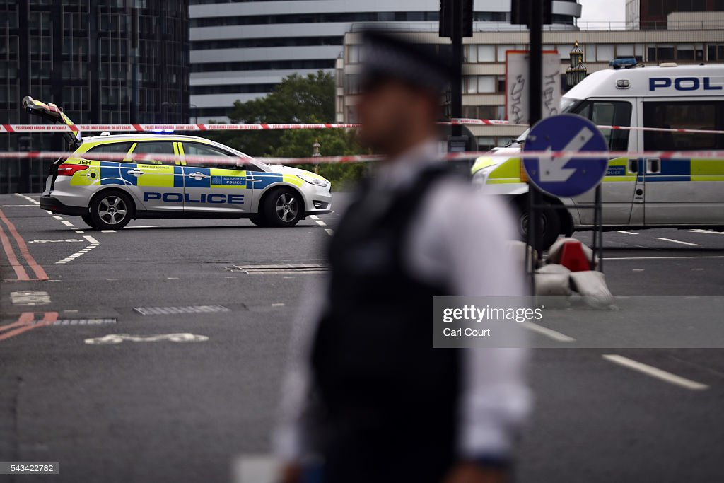 Police officers block a road after a car is left abandoned on Westminster Bridge on June 28, 2016 in London, England. Police officers closed off Westminster Bridge and secured the area after the abandoned car sparked a security alert that was later resolved when the owner of the car returned.