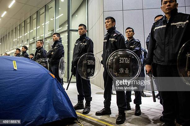Police officers block the entrance to the Legislative Council building after clashes with prodemocracy activists on November 19 2014 in Hong Kong...