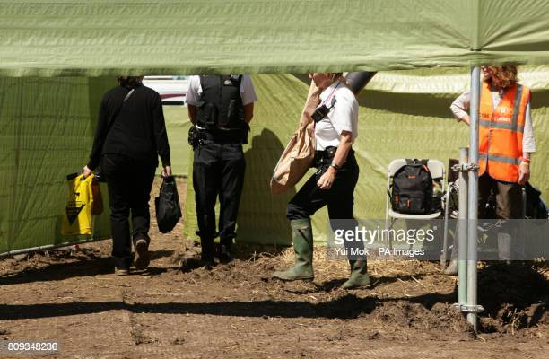 Police officers carry evidence bags into the hospitality area following the death of Christopher Shale at the Glastonbury Festival in Somerset