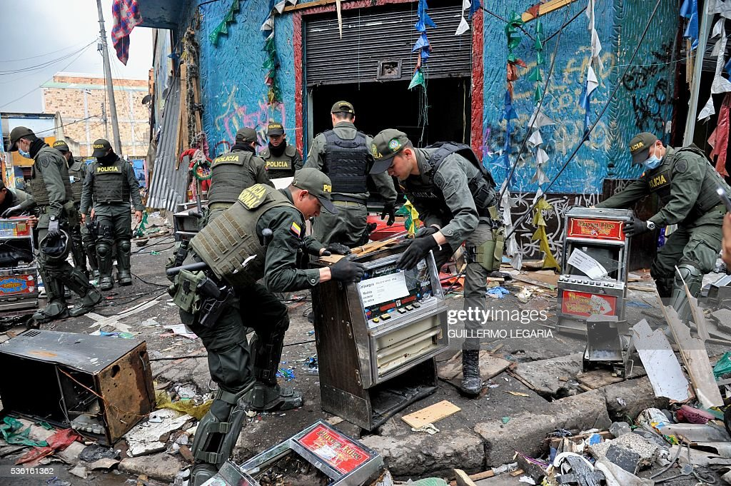 Police officers carry out a operation in the notorious section of Bogota known as The Bronx, plagued by rampant drug trafficking and prostitution rings, on May 31, 2016 just days after a raid. Thousands of police officers accompanied by city officials and Technical Investigation Corps (CTI) of the Prosecutor raided on Saturday the area plagued by drug addicts, prostitution and children who were sexually exploited. The police rescued some 200 young women and girls who were being held against their will and sexually exploited, city officials said. / AFP / GUILLERMO