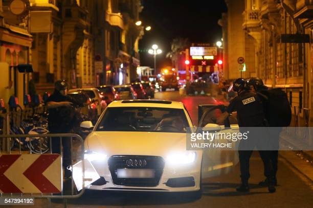 Police officers carry out checks on vehicles in the centre of French Riviera town of Nice after a truck drove into a crowd watching a fireworks...