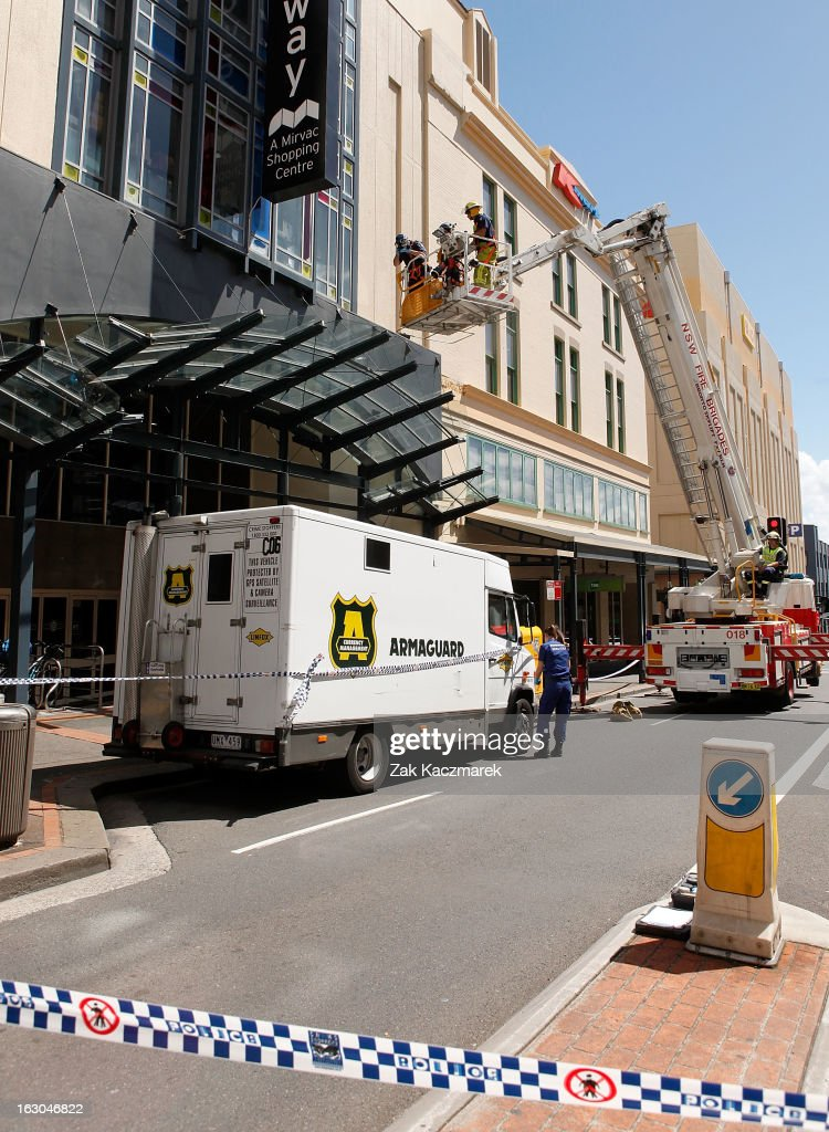 Police officers carry out investigations along Bay Street, Broadway on March 4, 2013 in Sydney, Australia. Shots were reportedly fired at an Armaguard truck and police are investigating what a spokesperson said appears to be an attempted robbery.
