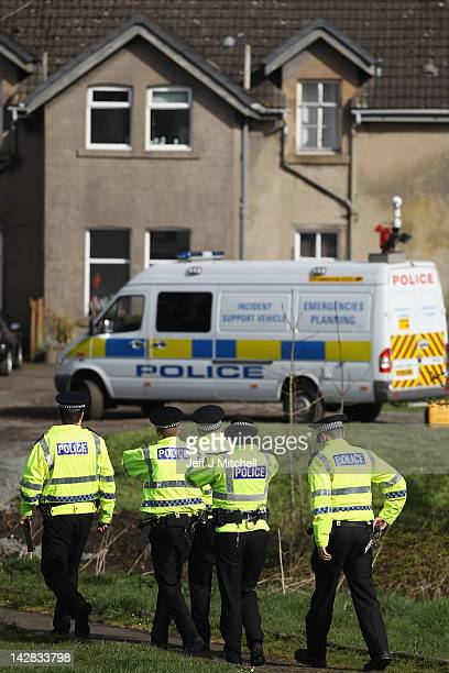 Police officers carry out searches at a farm in Kessington Road on April 13 2012 in Glasgow Scotland Strathclyde Police were alerted to a cache of...