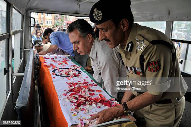 Police officers carry the coffin of one of the policemen who was killed in terror attack during a wreath laying ceremony at Police Control Room on...