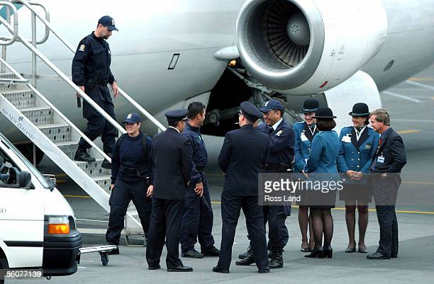 Police officers chat to pilots and aircrew of the Air New Zealand flight which will take Her Majesty Queen Elizabeth II from Wellington airport to...