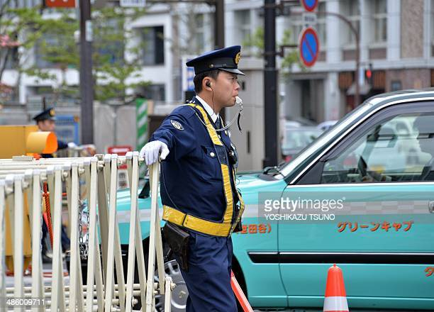 Police officers check a vehicles at a checkpoint near the US embassy in Tokyo on April 22 the day before US President Barack Obama arrives The US...