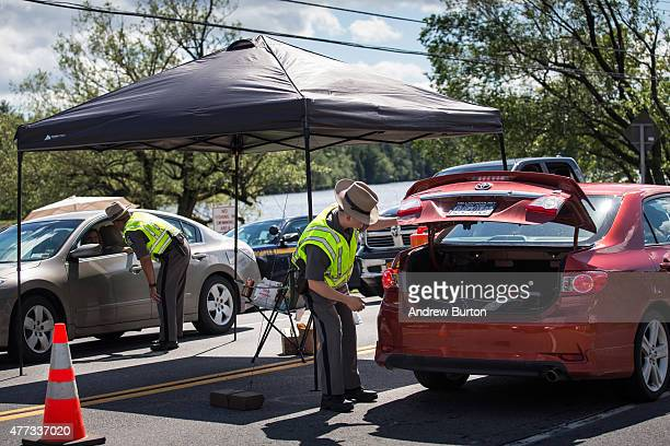 Police officers check automobiles for two escaped convicts at a mandatory check point June 16 2015 outside Dannemora New York A manhunt has been...
