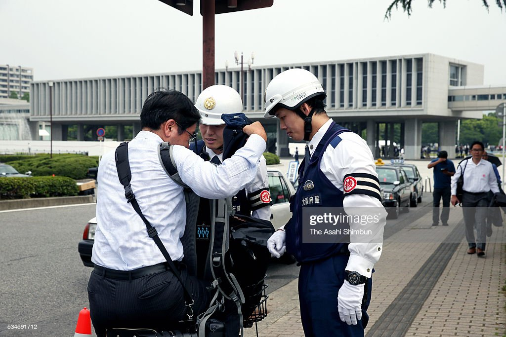 Police officers check inside the bag of a passers-by in prepration of the visit by U.S. President Barack Obama on May 27, 2016 in Hiroshima, Japan. Obama becomes the first sitting U.S. president to visit Hiroshima, where the first atomic bomb was dropped in 1945 at the end of World War II.