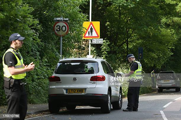 Police officers check vehicles on the roads surrounding The Grove hotel which is hosting the annual Bilderberg conference on June 6 2013 in Watford...