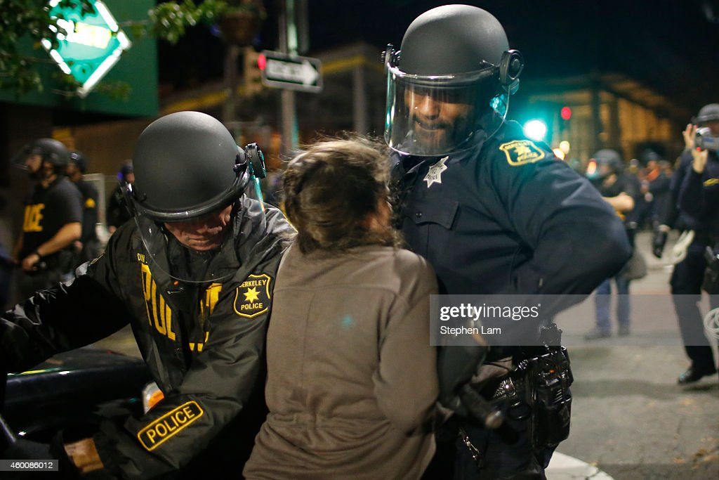 Police officers clash with a protester on the fourth night of demonstrations over recent grand jury decisions in policeinvolved deaths on December 6...
