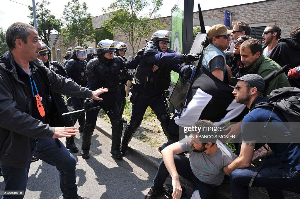 Police officers clash with protesters during a demonstration against controversial labour reforms on June 28, 2016 in Rennes. Unions have called repeated strikes and marches in opposition to the law, which seeks to bring down France's intractable 10-percent unemployment rate by making it easier to hire and fire workers.