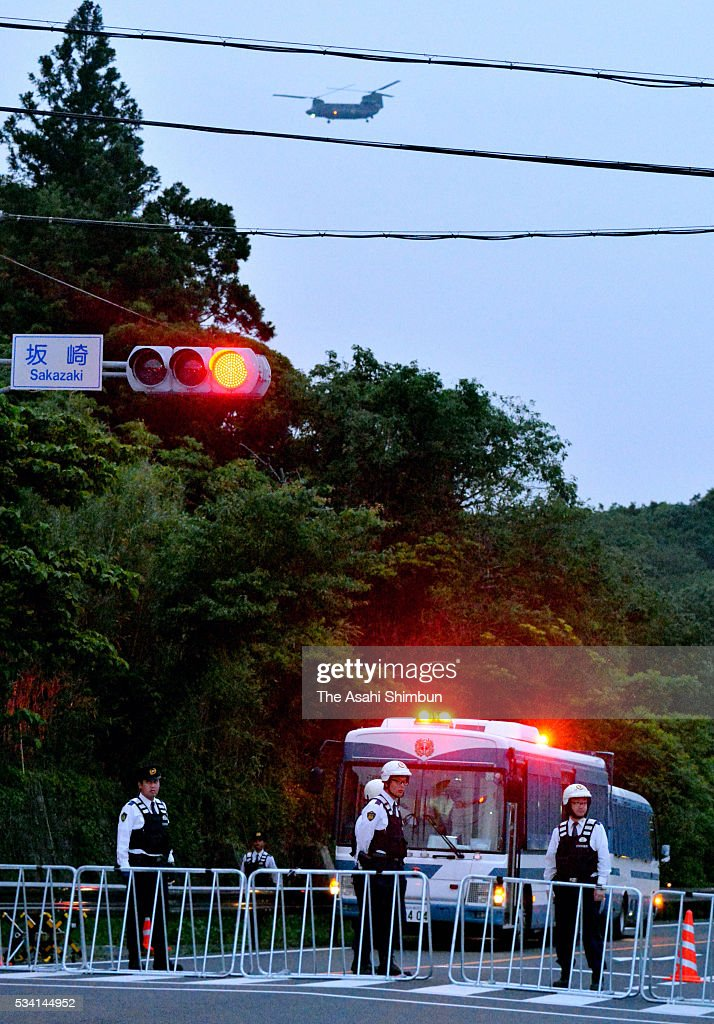 Police officers close a road leading to the heliport where world leaders are shuttled from Centrair International Airport on May 25, 2016 in Shima, Mie, Japan. The Group of Seven summit takes place on May 26 and 27 to discuss key global issues such as global economy and anti terrorism measures.