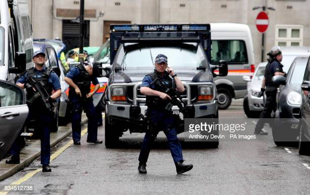Police officers close Park Street in Mayfair before raiding Park Lane Safe Deposit in connection with suspected money laundering operations London...