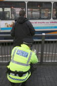 Police officers combating potential knifecrime stop and search people arriving in Liverpool by bus for traditional celebrations ahead of the festive...