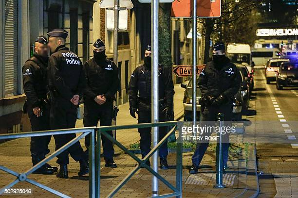 Police officers conduct new searches linked to Paris terrorist attacks on December 30 in Molenbeek Brussels The Belgian authorities are still looking...