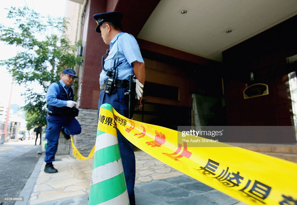 Police officers continue to investigate the apartment where a 15-year-old girl killed her classmate on July 28, 2014 in Sasebo, Nagasaki, Japan. According to the Nagasaki prefectural police, the student repeatedly struck the back of Aiwa Matsuo's head with a hand tool and strangled her with a rope in her apartment between 8 p.m. to 10 p.m. on July 26. Police confirmed the cause of death to be suffocation by cervical compression.
