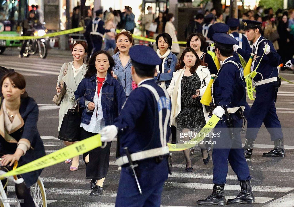 Police officers control the traffic around a sushi restaurant where U.S. President Barack Obama and Japanese Prime Minister Shinzo Abe have dinner on April 23, 2014 in Tokyo, Japan. The U.S. President is on an Asian tour where he is due to visit Japan, South Korea, Malaysia and Philippines.