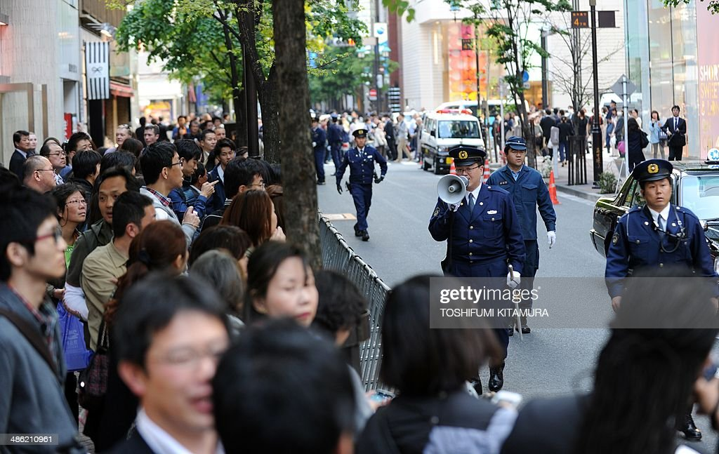 Police officers control the traffic in front of the 'Sukiyabashi Jiro' sushi restaurant at Ginza shopping district in Tokyo on April 23, 2014, hours before US President Barack Obama's visit. Obama will reportedly dine at a tiny Tokyo sushi restaurant, a place with three coveted Michelin stars but only a handful of seats, ruled with an iron rod by its redoubtable 88-year-old owner, Jiro. Obama will come to Tokyo for a three-day visit from April 23 for and will have dinner with Japanese Prime Minister Shinzo Abe.