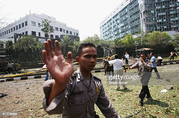 Police officers controls crowds outside the Australian Embassy following a bomb blast Thursday Sept 9 in Jakarta Indonesia A powerful explosion in...