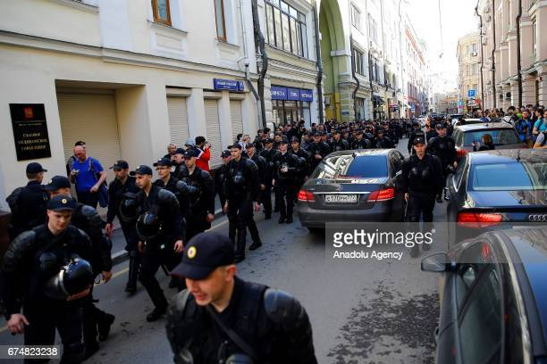 Police officers cordon off a street at the presidential administration building during a protest in Moscow Russia on April 29 2017
