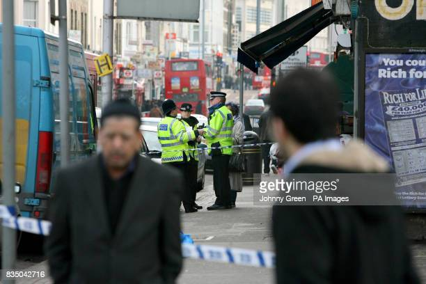 Police officers cordon off an area near the scene of a murder on London Road in west Croydon south London after a 26yearold man was fatally stabbed...