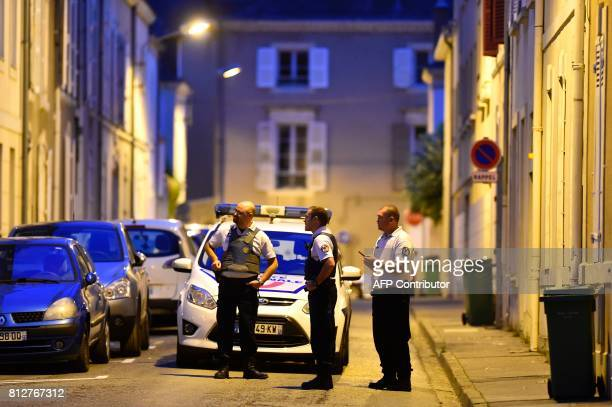 Police officers cordon off the area next to the house of late French magistrate JeanMichel Lambert who was found dead at his home on July 11 in Le...
