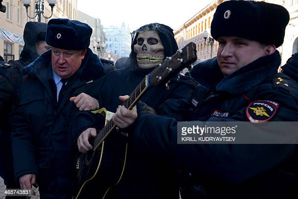 Police officers detain a trade union activist for taking part in an unauthorized staged protest in support of a union of Russian pilots at Moscow's...