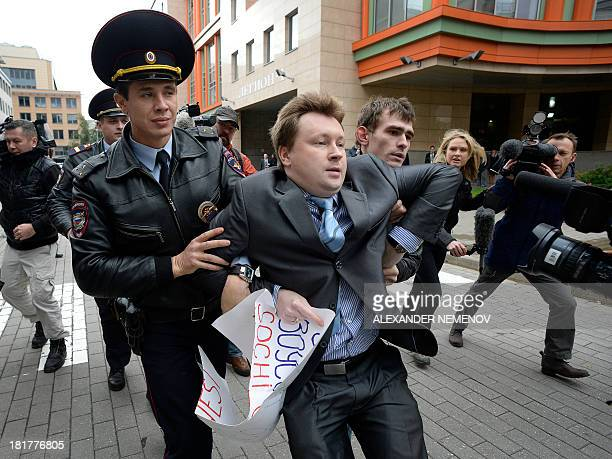 Police officers detain gay rights activist Nikolai Alexeyev during an unauthorized protest against hotly disputed Russian laws banning the promotion...