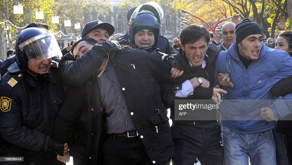 Police officers detain opposition activists as they try to hold an unauthorized rally to demand the resignation of President Ilham Aliyev at the Fountains Square in central Baku, the capital of Azerbaijan, on December 10, 2012. Police dispersed today the unauthorized pro-democracy protest.