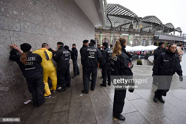 Police officers detain people during Weiberfastnacht celebrations as part of the carnival season on February 4 2016 in Cologne Germany Carnival...