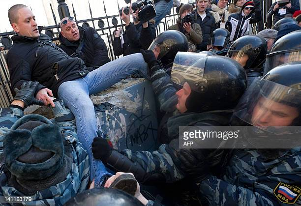 Police officers detain Radical leftist leader Sergei Udaltsov in the central Arbat area in Moscow on March 10 shortly after an antiPutin rally Moscow...